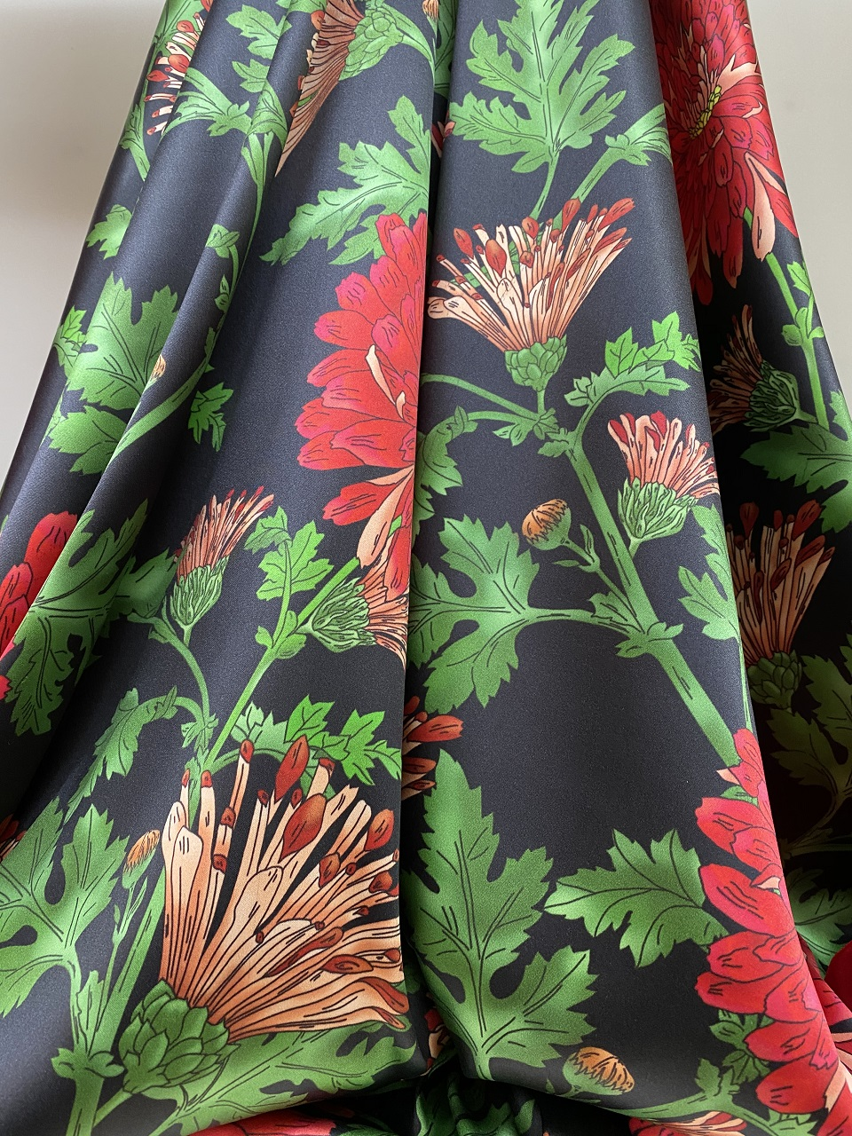 black silk fabric with flowers print